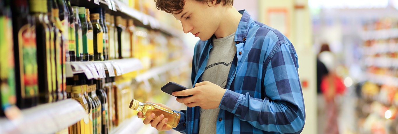 Man viewing nutrition label on product