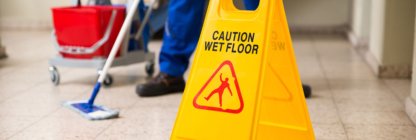 Wet floor with caution sign