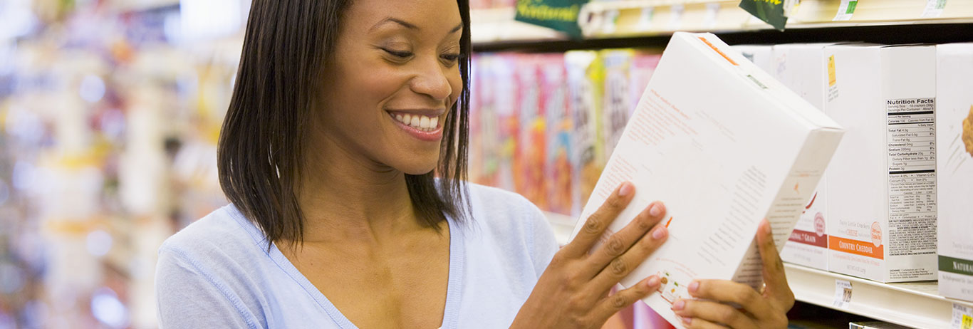 Woman reviewing food label